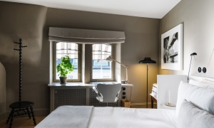 in-this-bedroom-on-the-top-floor-a-desk-area-overlooks-the-ostermalm-neighborhood-and-is-equipped-with-heated-floors-each-room-also-has-its-own-brass-cocktail-cabinet